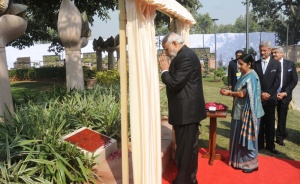 Prime Minister Narendra Modi Paying homage to the commemorating officers who laid down their lives in national service at Heads of Missions Conference, in New Delhi on February 07, 2015. Union Minister for External Affairs and Overseas Indian Affairs Sushma Swaraj is also seen.