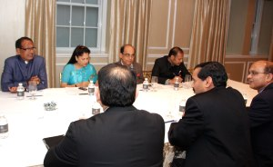 Chief Minister Shivraj Singh Chouhan and State Minister for Industry  Yashodhara Raje Scindia meeting investors in New York
