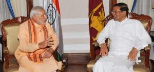 Prime Minister Narendra Modi meets Sri Lanka President Maithripala Sirisena in Colombo Photo courtesy: M. Asokan