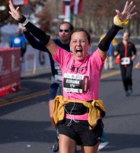 A runner rejoices at the 2014 Philadelphia Marathon. Source: City of Philadelphia-Priorities & Accomplishments Update