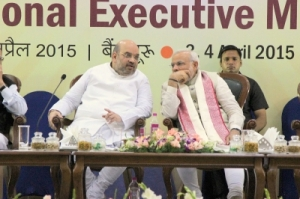 Prime Minister Narendra Modi ruling party president Amit Shah at the Inauguration of the BJP National Executive Meeting at Hotel Ashoka, Bengaluru April 03, 2015
