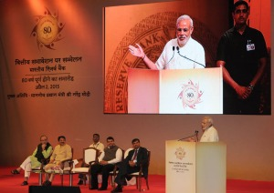 Prime Minister Narendra Modi addressing the Financial Inclusion Conference of RBI, in Mumbai on April 02, 2015. Union Minister for Finance, Corporate Affairs and Information & Broadcasting Arun Jaitley, Governor of Reserve Bank of India, Raghuram Rajan, Governor of Maharashtra C. Vidyasagar Rao and Chief Minister of Maharashtra Devendra Fadnavis are also seen.