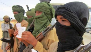 Four boys, as young as 12 and 14 years old, fight for a rebel group in northern Mali. International observers report that extremist rebel groups have kidnapped, recruited, and paid for large numbers of child soldiers in the country.
