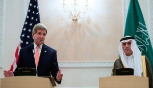 Saudi Foreign Minister Adel al-Jubeir looks on as U.S. Secretary of State addresses reporters during a news conference at Riyadh Air Base in Riyadh, Saudi Arabia, on May 7, 2015, following meetings with King Salman bin Abdelaziz Al Saud, Crown Prince Mohammed bin Nayef, and the Foreign Minister.