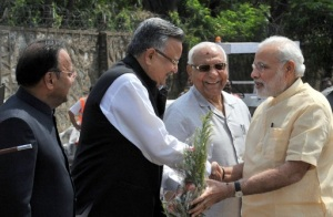 Prime Minister Narendra Modi being welcomed by Governor of Chhattisgarh Balramji Das Tandon and the Chief Minister of Chhattisgarh Raman Singh, at Jagdalpur Airport, in Chhattisgarh on May 09, 2015.