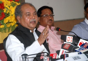 Union Minister for Mines and Steel Narendra Singh Tomar addressing a press conference to mark the completion of one year of the NDA government, in Bhopal on June 08, 2015. Minister of State for Mines and Steel Vishnu Deo Sai is also seen.