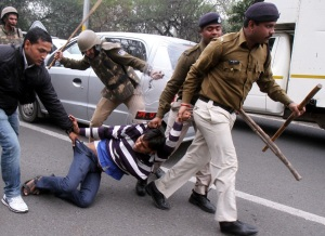 In this file photo, Police is seen dragging a Congress worker protesting near Madhya Pradesh Home Minister Babulal Gaur's residence to demand CBI investigation in the Vyapam scam in Bhopal on Jan.21, 2014
