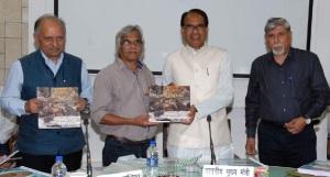 "Madhya Pradesh Chief Minister Shivraj Singh Chouhan launched ""Vultures of Panna"" authoried by senior journalist Abhilash Khandekar and renowned photographer Bhalu Monde"