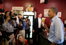 President Barack Obama eats ice cream as the press covers his visit to the Grand Ole Creamery on Grand Avenue in St. Paul, Minn., June 26, 2014. (Official White House Photo by Pete Souza)