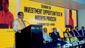 Nadhya Pradesh Chief Minister is seen addressing the Make in India event in Mumbai on Wednesday.  Also seen seated on dais are State Commerce and Industries Minister Yashodhara Raje Scindia and Chief Secretary Anthony de Sa