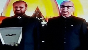 "India's Minister for Environment and Forest Prakash Javadekar and Pakistan´s High Commissioner to India Abdul Basit at the ""Pakistan Day"" function at the High Commissione of Pakistan in New Delhi on 23 March 2016"