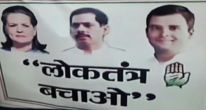 Placard with Robert Vadra photo