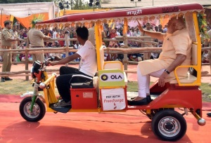 PM Modi riding an e-rickshaw in Varanasi on 1 May 2016