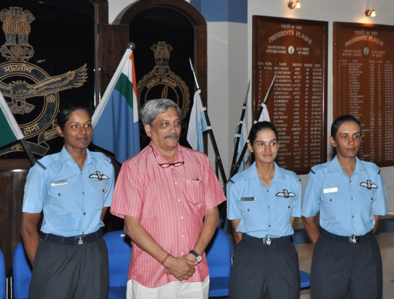 India's Minister for Defence Manohar Parrikar with three newly commissioned women fighter pilots Flying Officer Avani Chaturvedi, Flying Officer Bhavana Kanth, Flying Officer Mohana Singh, at Air Force Academy, Hyderabad on June 18, 2016.
