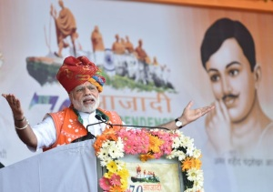 Prime Minister Narendra Modi addressing a public meeting to mark the launch of 70th Freedom Year Celebrations at Bhabra village in Alirajpur district of Madhya Pradesh on August 09, 2016.