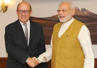 Defence Minister of France Jean-Yves Le Drian and Prime Minister Narendra Modi