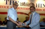 Lalit Shastri (R) being honoured by The Hindu