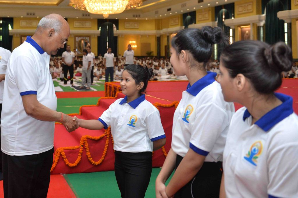President of India Ram Nath Kovind interacting with the children during the inauguration of an event to mark the International Day of Yoga at Ceremonial Hall, Rashtrapati Bhavan Cultural Centre on June 21, 2019.