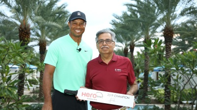Dr. Pawan Munjal, Chairman, Hero MotoCorp, handing over the trophy to Tiger Woods the 'Hero Shot 2019' winner, ahead of the Hero World Challenge 2019