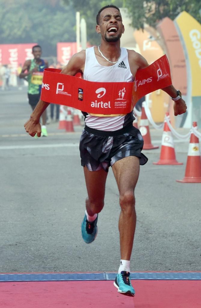 Defending champion Andamlak Belihu retains his men's title at the 15th Delhi Half Marathon, at Jawaharlal Nehru Stadium in New Delhi, Sunday, Oct. 20, 2019. Photo Piyal Bhattacharjee