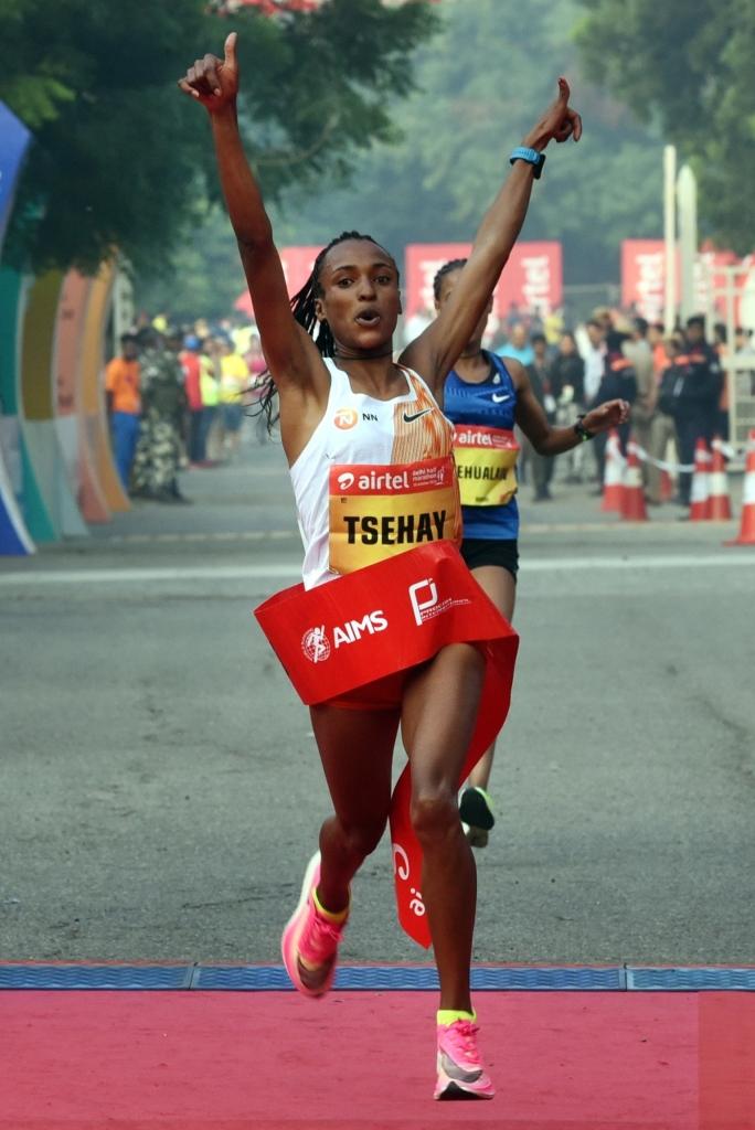 Ethiopia's Tsehay Gemechu celebrates after crossing the finish line during the Airtel Delhi Half Marathon in New Delhi on Sunday. Photo Piyal Bhattacharjee